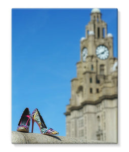 Canvas print showing Liverpool liver building with pair of multi-coloured high heeled shoes in foreground