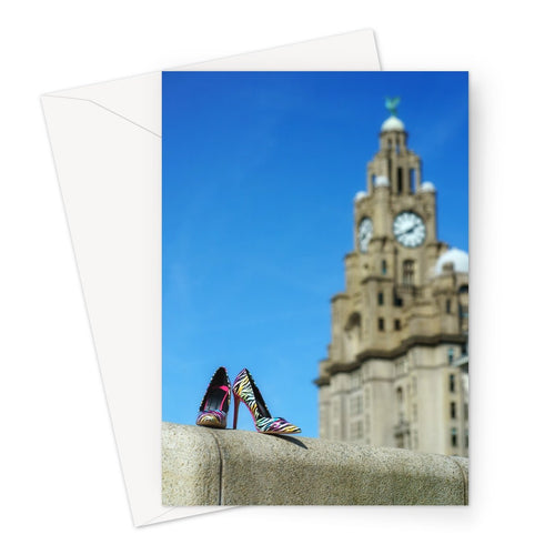 Greeting card showing Liverpool liver building with pair of multi-coloured high heeled shoes in foreground