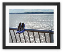 Load image into Gallery viewer, Framed print with black border of women's shoes on railings next to River Mersey