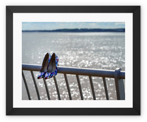 Framed print with black border of women's shoes on railings next to River Mersey