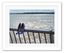 Load image into Gallery viewer, Framed print with white border of women's shoes on railings next to River Mersey