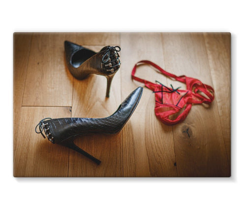 canvas  print showing pair of red knickers abandoned on wooden floor next to pair of black high heeled ladies shoes