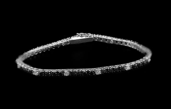 OC FOREVER 18K WHITE GOLD TENNIS BRACELET WITH BLACK AND WHITE DIAMONDS