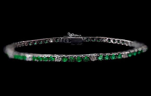 OC FOREVER 18K WHITE GOLD TENNIS BRACELET WITH DIAMONDS AND EMERALDS