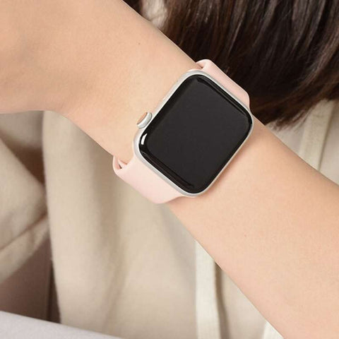 Woman's arm wearing an Apple Watch with silicone sport band in soft pink sand