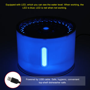 Cat water fountain glowing with blue LED light at night