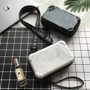 Mini Suitcase Shaped Crossbody Handbag and Clutch in white and black marble patterns