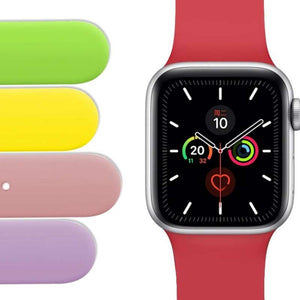 Apple Watch silicone sport bands in multicolors of green, yellow, pink and lavendar and an Apple Watch with red silicone band on white background