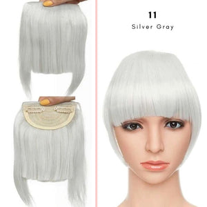 Clip On thick blunt bangs in synthetic hair in silver grey