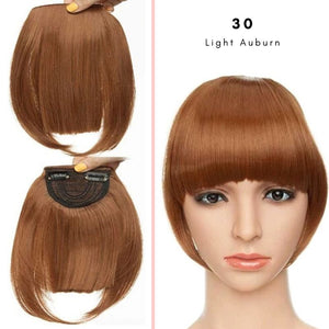 Clip On thick blunt bangs in synthetic hair in light auburn