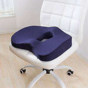 Navy Orthopedic Coccyx Cushion on a white chair