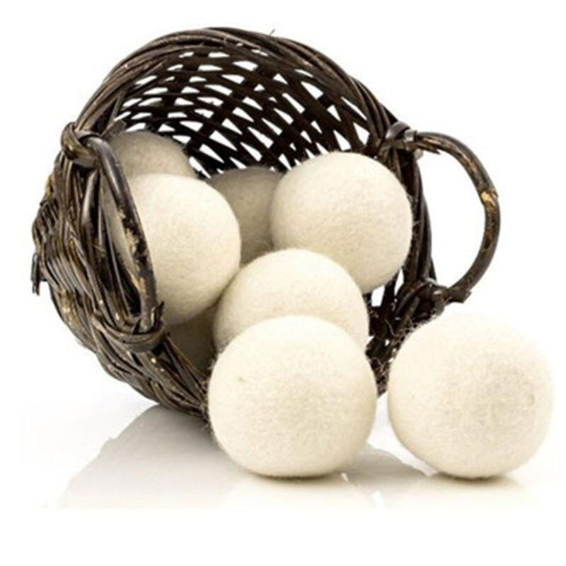 A brown tipped basket with wool dryer balls spilling out of it