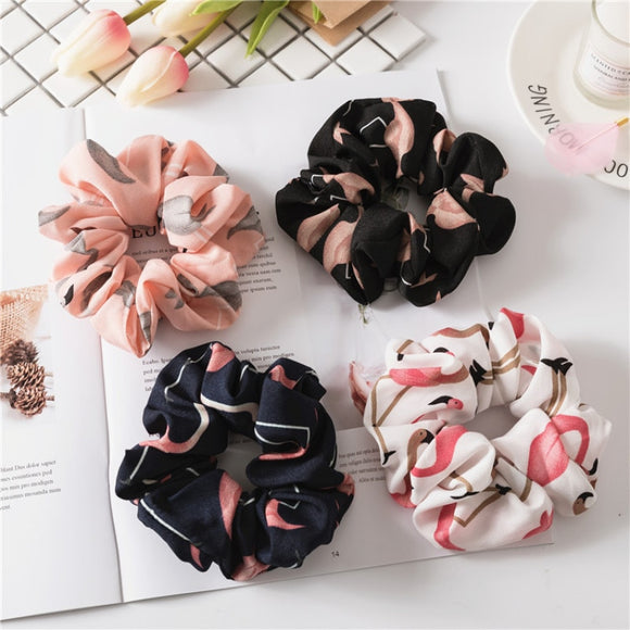Four flamingo scrunchies