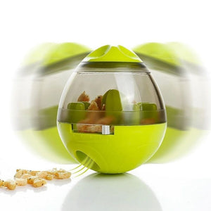 Green colored Interactive Pet Treat Dispenser wobbling and dispensing snacks