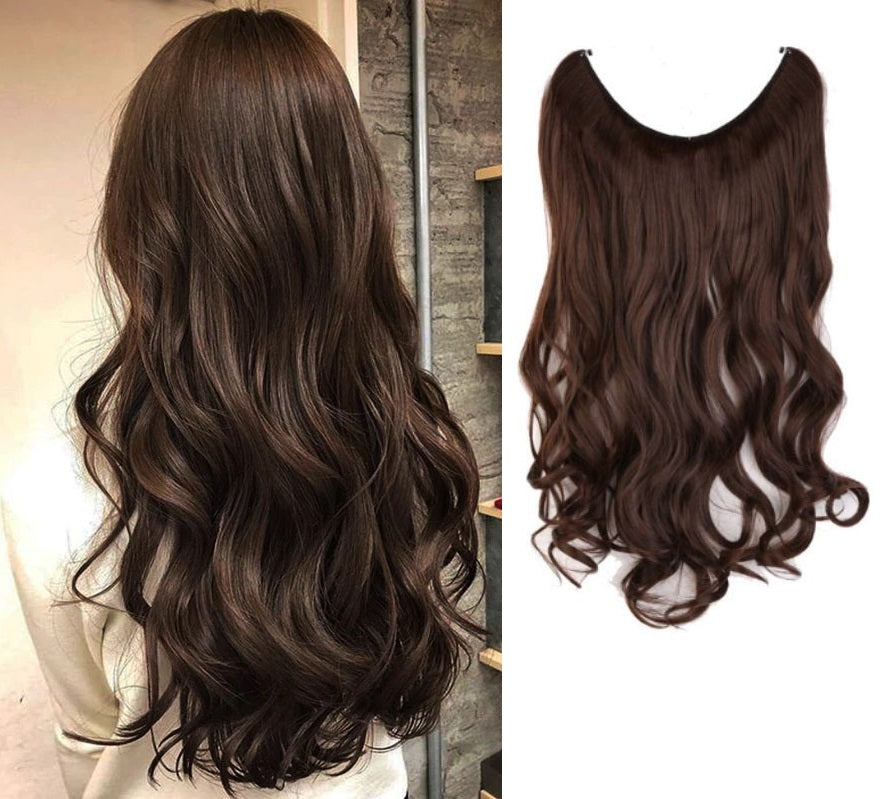 Woman wearing the Invisible Wire Halo Hair Extension in Dark Brown with curls