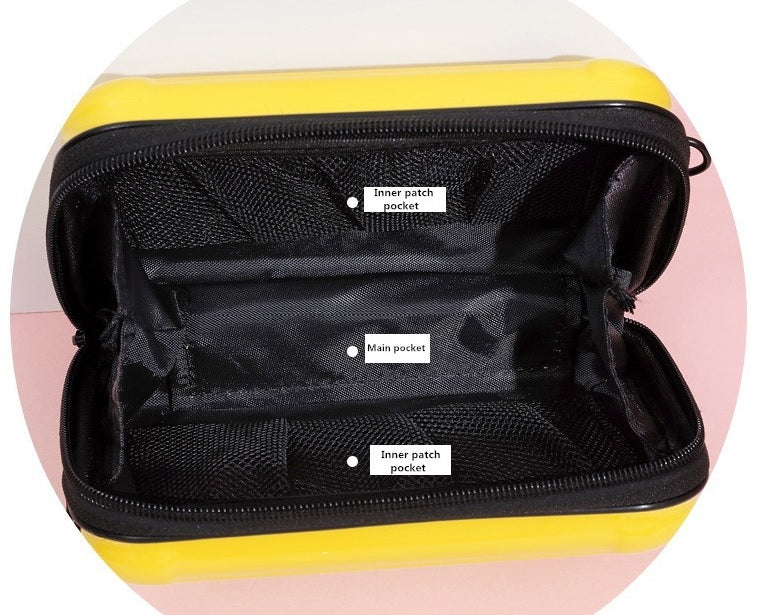 Mini suitcase handbag opened, showing compartments inside