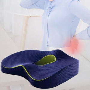 Orthopedic Coccyx Cushion in navy. Small insert of an image of woman holding her back in pain