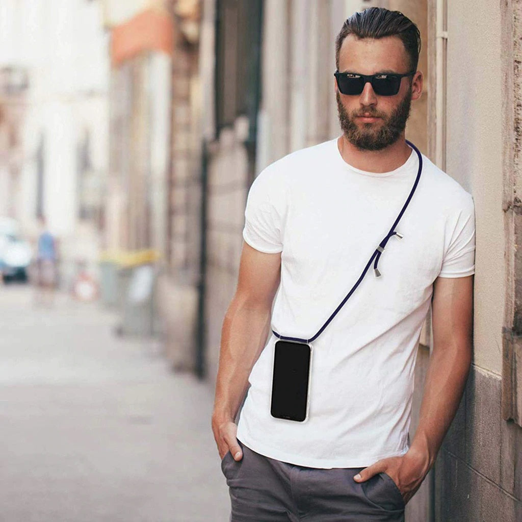 Handsome man in white t shirt wearing iPhone case with black cord like a crossbody sling