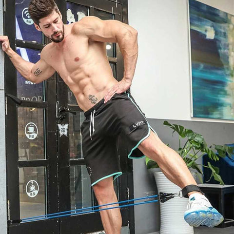 Hook resistance bands to doors and work out your legs using the ankle strap