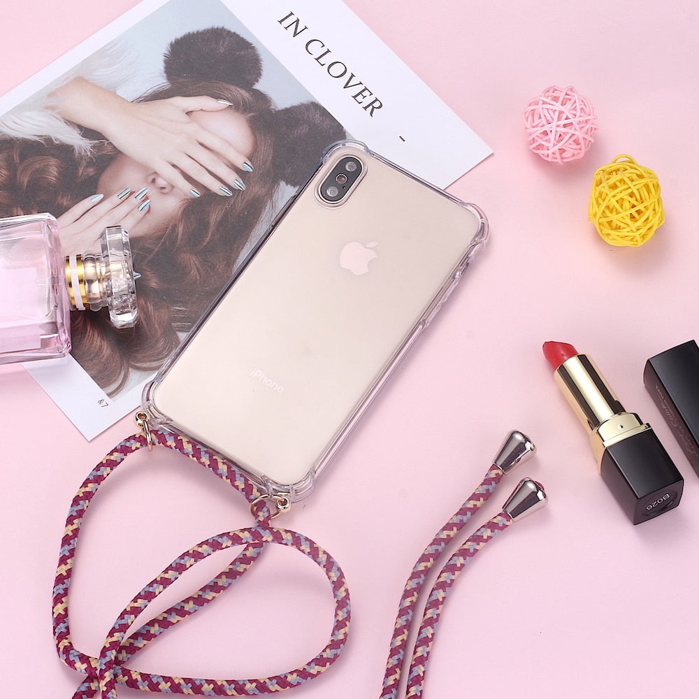 Instagram flatlay of iPhone case with 3 color cord on pink background.