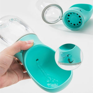 Slide button to On and then press center button to fill drinking cup with water