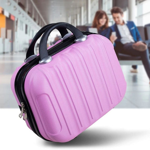 Hardshell Toiletry Bag for Women in pink with back blurred image of a man and woman sitting in an airport lounge