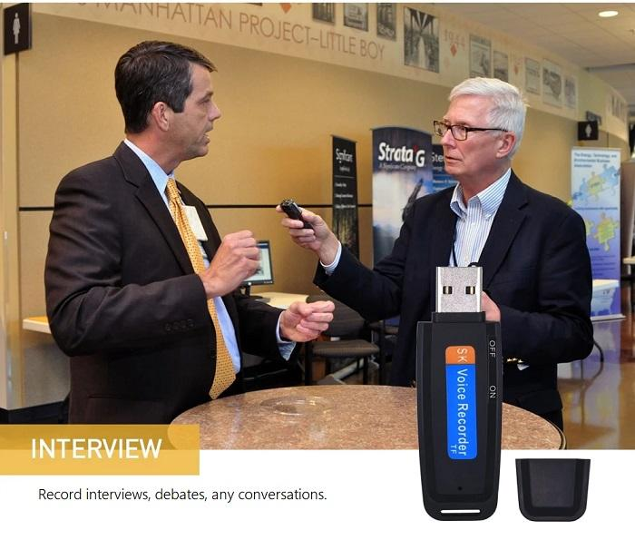 Discreet USB recorder in black against an image of a man interviewing another man