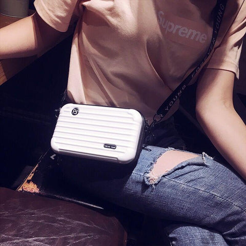Woman wearing the White Mini Suitcase Shaped Crossbody Handbag & Clutch as a crossbody