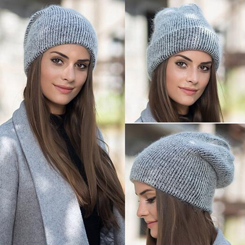 Model wearing gray beanie with gray jacket