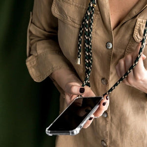 Girl wearing the iPhone necklace, holding her phone