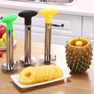 Cored pineapple, pineapple rings on plate, pineapple corer in green, black and yellow next to it