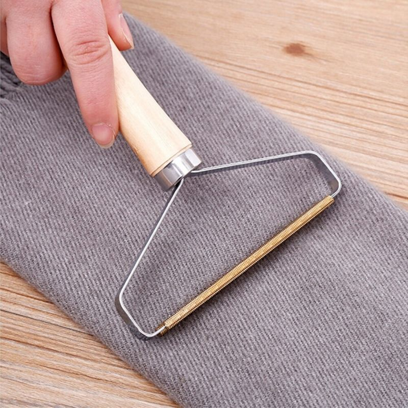 Fabric Shaver Lint Remover shaving a scarf