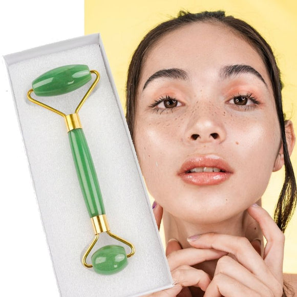 Jade face roller with picture of woman with glowing skin on yellow background