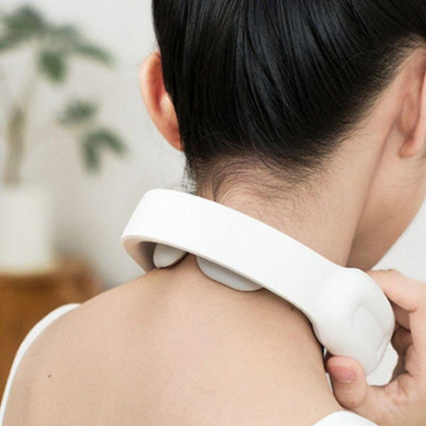 Close up of the back of the neck massager on a woman's back of neck