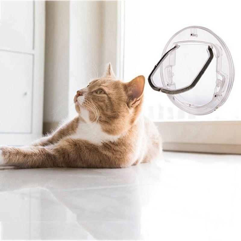 Orange cat lying on the floor next to the Transparent Pet Door which is installed on a glass sliding door
