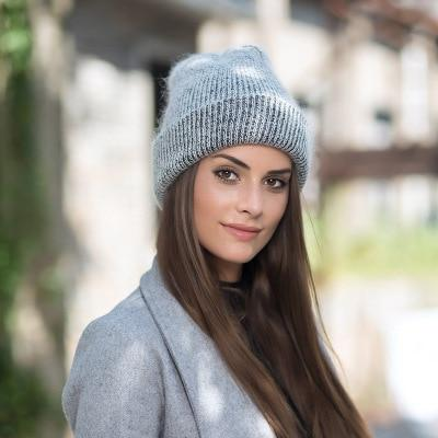 Model wearing gray beanie
