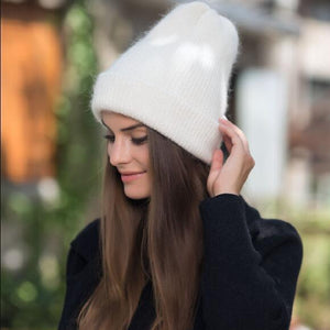 Model wearing white beanie with black turtle neck
