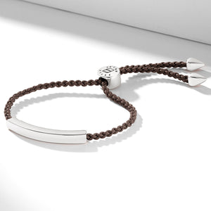 Nylon bracelet with an engravable silver nameplate