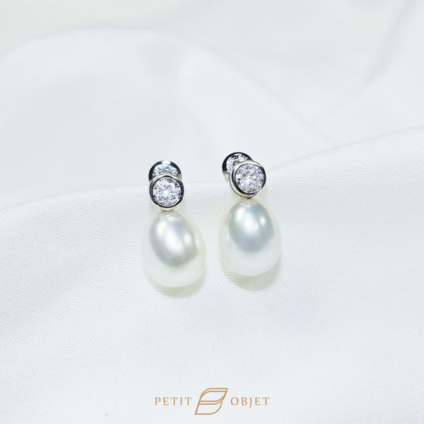 White pearl earrings with glittering diamond