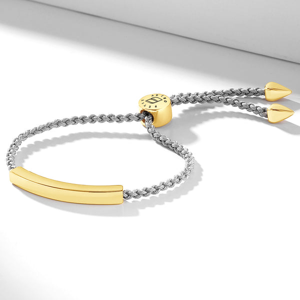 Nylon bracelet with an engravable gold nameplate