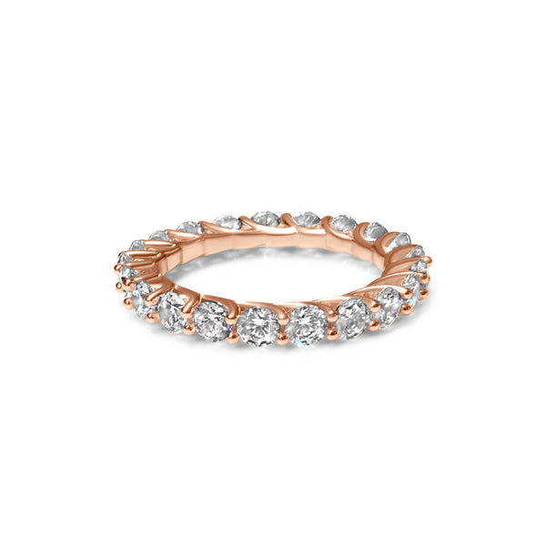 Rose gold ring surrounded by diamonds
