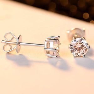 6 –prong diamond earrings plated in white gold