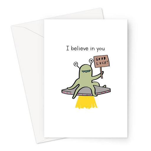 I Believe In You Greeting Card | Cute, Funny Alien Good Luck Card, Alien Sitting On UFO Holding Good Luck Sign, Flying Saucer