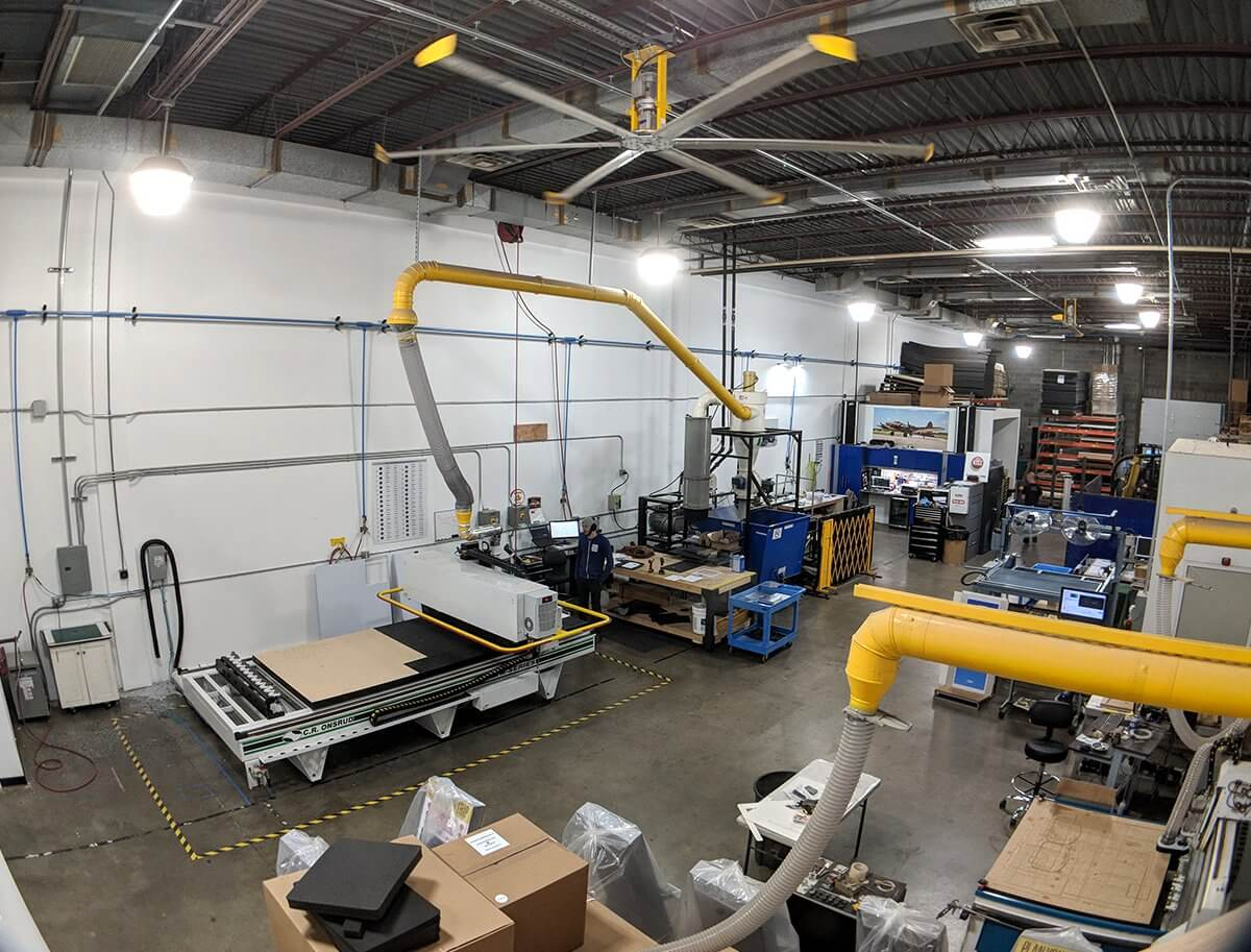 A photo of our warehouse, featuring CNC machines for cutting materials.