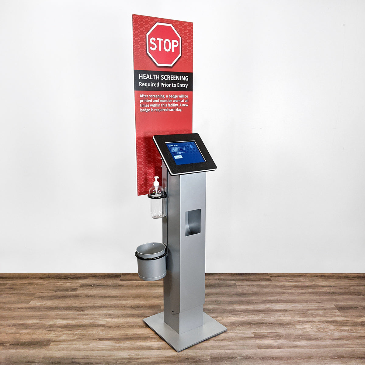 A printer kiosk with branded signage to make it clear that visitors and employees must check in before entering.