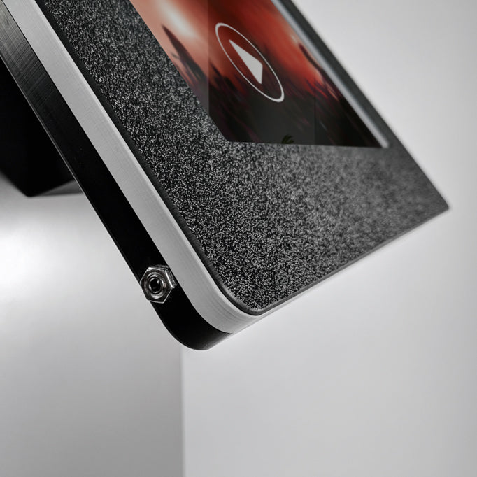 A 3.5mm audio jack port attached to the tablet enclosure.