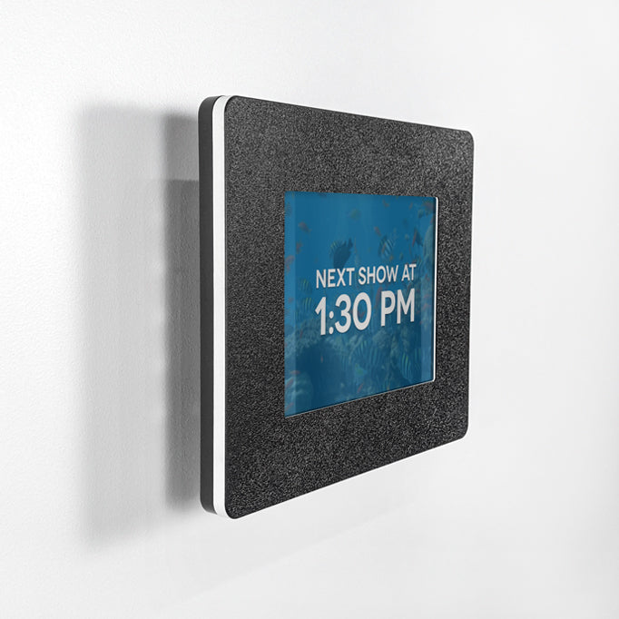 A tablet enclosure that mounts parallel to a wall for digital signage or video.