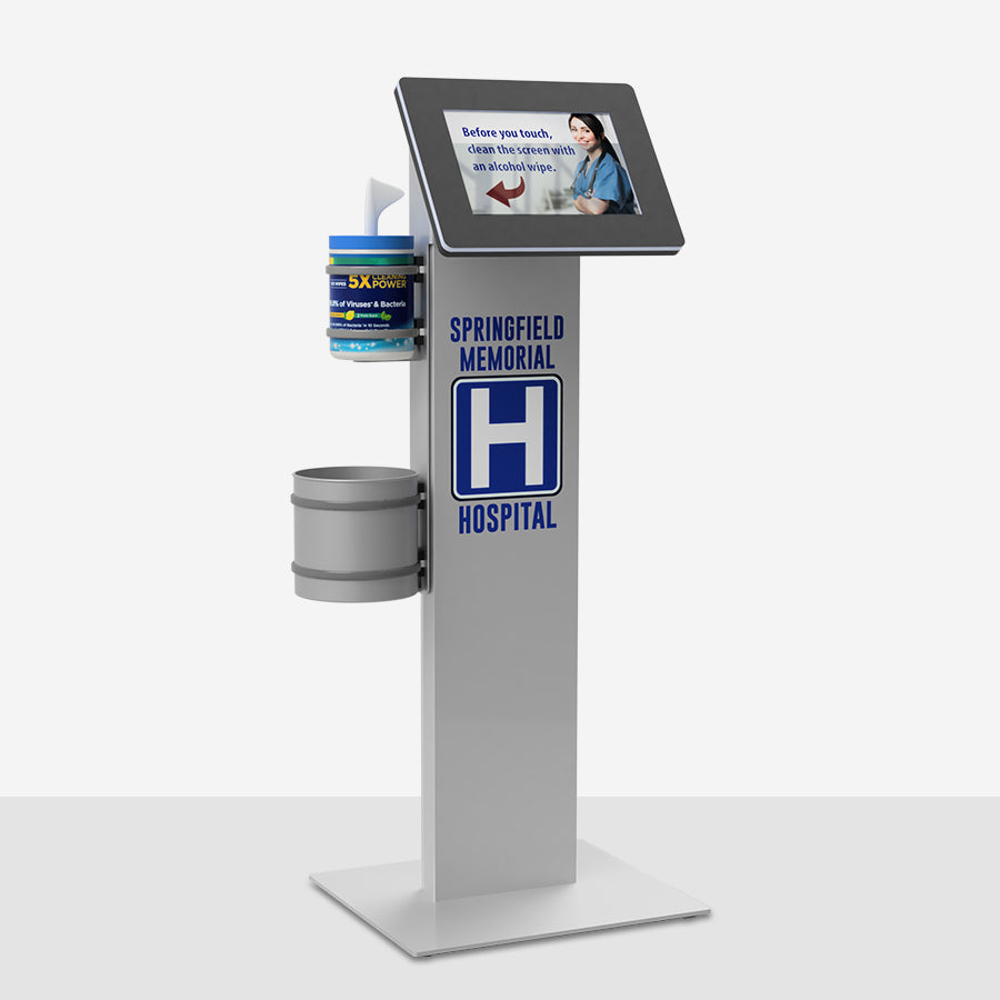 A kiosk enclosure with a sanitation wipe dispenser and garbage bin.