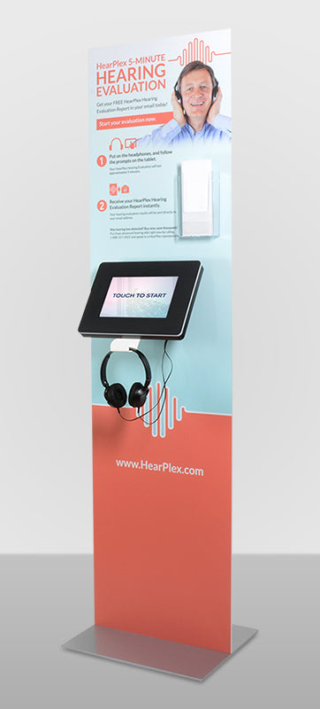 A countertop kiosk sitting on a table with a card reader.