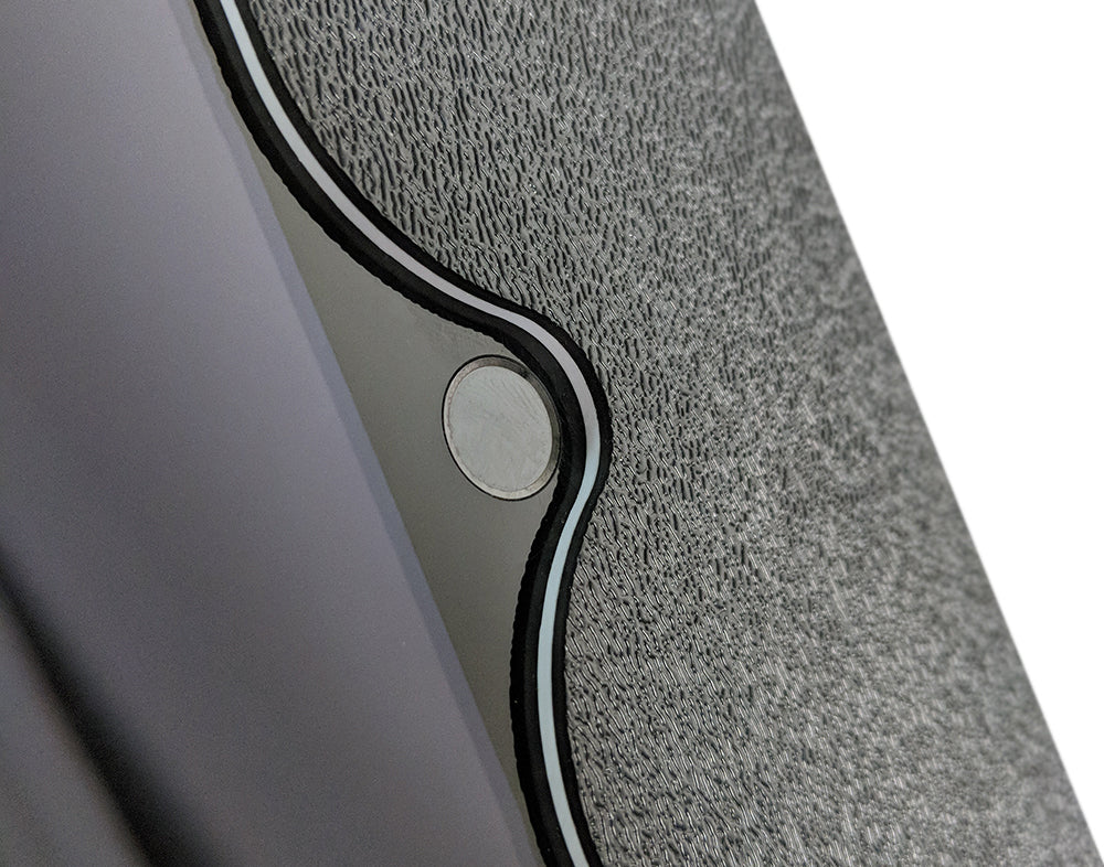 A cutout in the tablet enclosure for easy home button access.